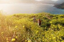 Couple hiking towards the coastline