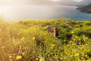 Couple hiking towards the coastline