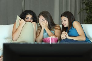 Girls watching a terror movie on tv.jpg
