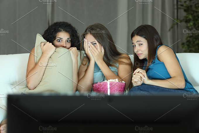 Girls watching a terror movie on tv.jpg - Arts & Entertainment