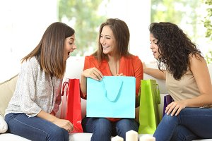 Happy shoppers with shopping bags.jpg