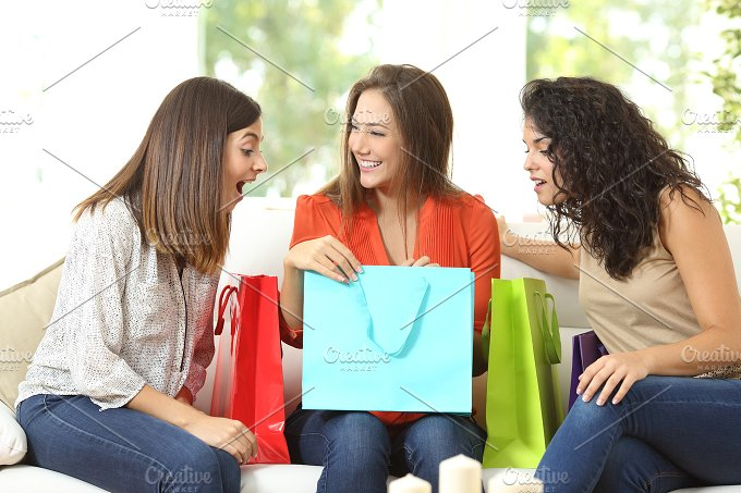 Happy shoppers with shopping bags.jpg - People