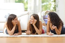 Group of teen friends talking at home.jpg