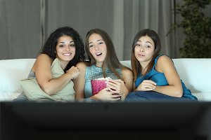 Three friends watching romantic movie on tv.jpg