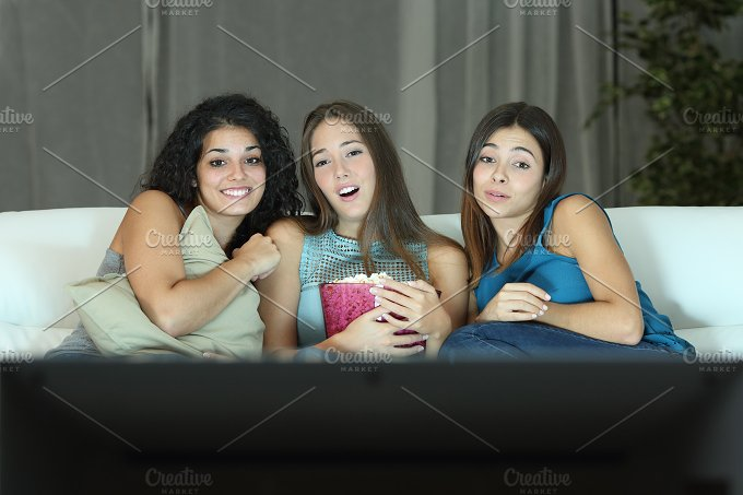Three friends watching romantic movie on tv.jpg - Arts & Entertainment