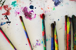paint brushes, stained canvas backgr