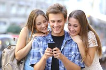 Friends sharing media in a smart phone.jpg