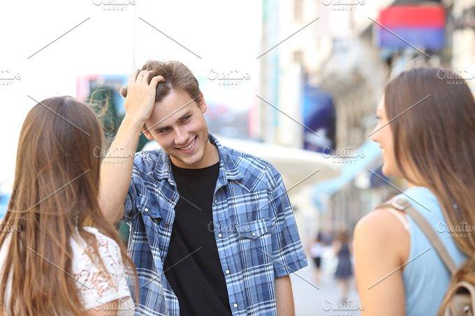 Man flirting with girls in the street.jpg - People