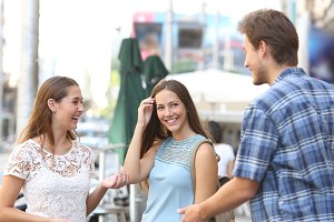 Girl with a friend flirting with a boy in the street.jpg