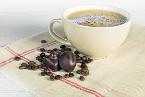 coffee mug with chocolate candies
