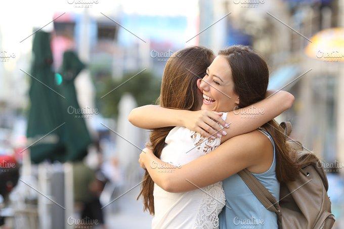 Happy meeting of friends hugging.jpg - People