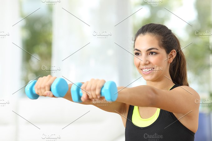 Fitness girl doing weights at home.jpg - Sports