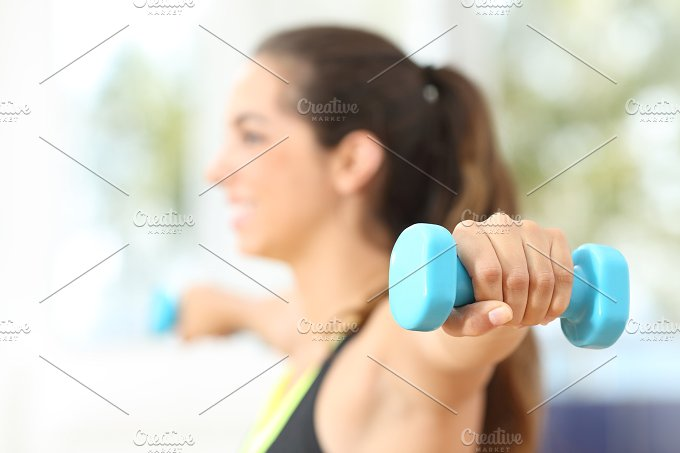 Fitness woman doing weights at home.jpg - Sports