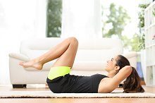 Fitness girl doing crunches at home.jpg