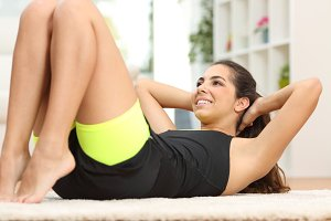 Fitness woman doing crunches on the floor.jpg