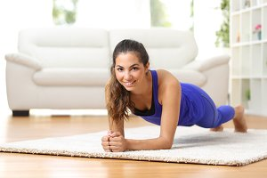 Fitness woman exercising at home.jpg