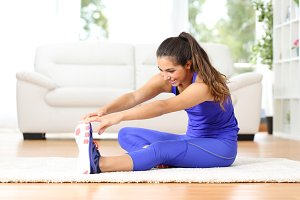 Fitness woman stretching legs at home.jpg