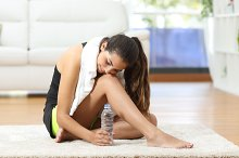 Tired fitness woman resting after sport.jpg