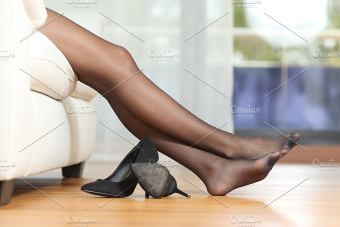 Tired woman legs resting on couch.jpg - Beauty & Fashion