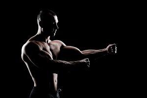 bodybuilder demonstrates biceps
