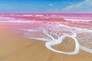 Heart shape of wave with pink sea