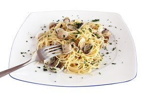 spaghetti with clams over white