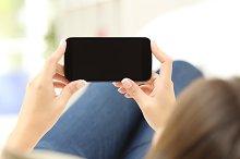 Woman watching media in a smart phone.jpg