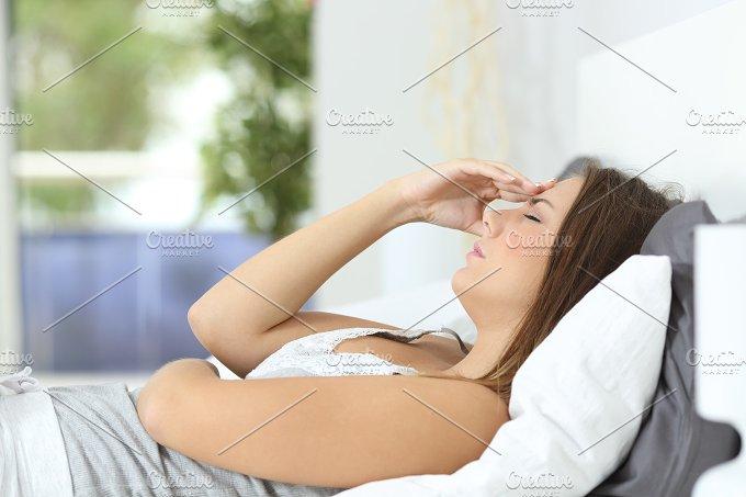 Profile of a woman suffering head ache at home.jpg - Health