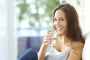 Girl drinking water at home.jpg