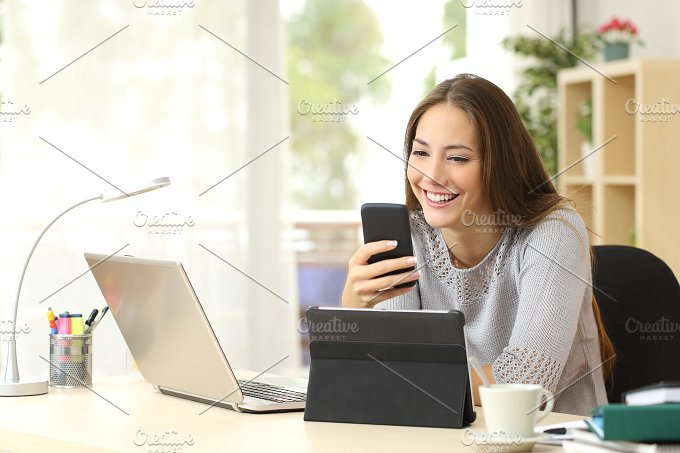 Woman using multiple devices at home.jpg - Technology