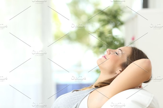 Woman relaxing lying on a couch at home.jpg - Health