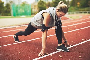 Fit woman stretching after run
