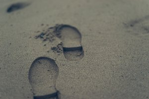 footprint on the wet sand