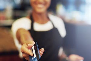 Waitress handing over credit card