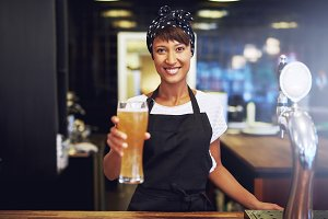 Waitress handing over a beer