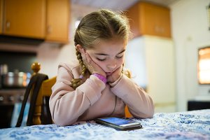 blonde girl using a smart phone