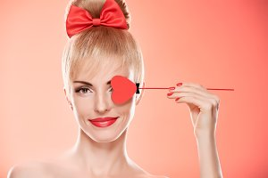 Beauty woman smiling with red heart.