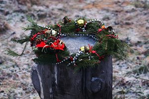Christmas wreath on tree stump