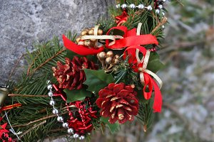 Christmas wreath with red cones