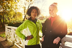 Two women getting ready to run