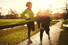Two women stretching after a run