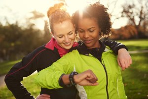 Smiling fit women working out