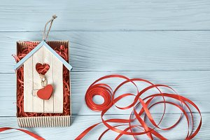 Valentines Day. Love hearts, gift box on wood