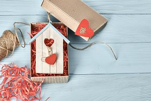 Valentines Day. Love heart gift box, twine on wood