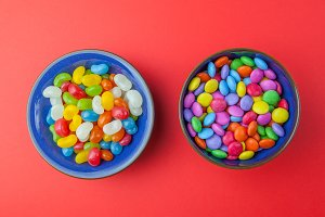 Candy sweets on red background