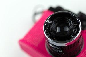 Pink camera lens closeup