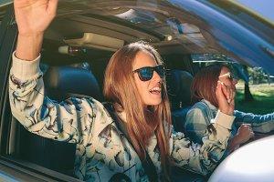 Happy woman having fun inside of car