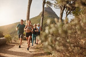 Group of fit people trail running
