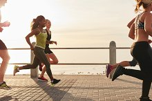 Woman running with friends