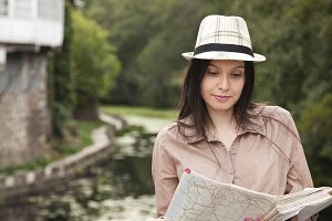 Travel girl looking at the map